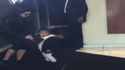Kim Kardashians Runs to the rescue as Baby North West Stops for Paparazzi