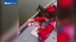 HOW CUTE! Little girl reels in a 20-inch fish using her plastic barbie fishing rod