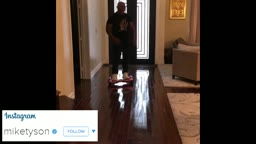 Mike Tyson falls off his hoverboard